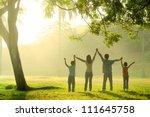 an asian family jumping in joy... | Shutterstock . vector #111645758