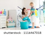 mother and kids in laundry room ... | Shutterstock . vector #1116467018
