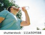 man drinking water in hot... | Shutterstock . vector #1116509588