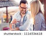 lovely romantic couple sitting... | Shutterstock . vector #1116536618