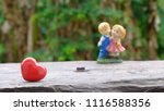 red heart on wooden with couple ... | Shutterstock . vector #1116588356