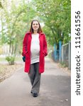 Portrait of pregnant woman walks september park - stock photo