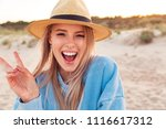 photo of happy excited young...   Shutterstock . vector #1116617312
