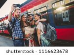 group of friends traveling by... | Shutterstock . vector #1116623678