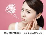 young woman checking her skin.... | Shutterstock . vector #1116629108
