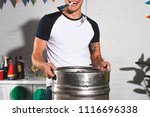 cropped shot of happy young man ... | Shutterstock . vector #1116696338