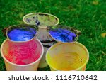 sun glasses on top of plastic...   Shutterstock . vector #1116710642