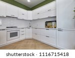 kitchen with appliances and a... | Shutterstock . vector #1116715418