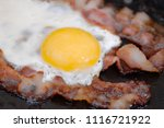 close up fried eggs with bacon...   Shutterstock . vector #1116721922