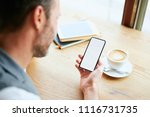 closeup of man at cafe with... | Shutterstock . vector #1116731735