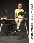 Smiling Schoolboy Holding Apple ...