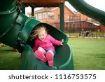 cute little girl having fun on... | Shutterstock . vector #1116753575