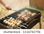 cooking mushrooms and meat on... | Shutterstock . vector #1116761756