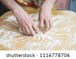 male hands preparing dough for... | Shutterstock . vector #1116778706