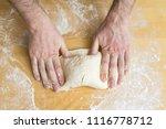 male hands preparing dough for... | Shutterstock . vector #1116778712
