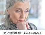 portrait of tired senior woman | Shutterstock . vector #1116780236
