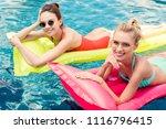 happy young women lying on... | Shutterstock . vector #1116796415