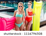 happy young women with... | Shutterstock . vector #1116796508