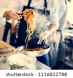 chef cooking spaghetti in the... | Shutterstock . vector #1116822788