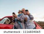 happy elderly senior couple use ... | Shutterstock . vector #1116834065