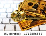 golden eos.io and mound of... | Shutterstock . vector #1116856556