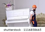 loader moves piano instrument.... | Shutterstock . vector #1116858665