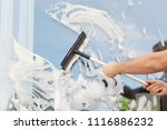 male cleaner wiping window... | Shutterstock . vector #1116886232