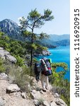 the tourists with a backpacks... | Shutterstock . vector #1116920915
