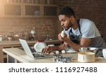 black man baking pastry and... | Shutterstock . vector #1116927488