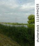 dutch ditch  friesland | Shutterstock . vector #1116944255