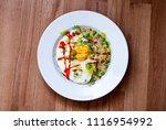 salty porridge with egg and... | Shutterstock . vector #1116954992