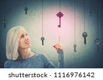 young woman pointing finger to... | Shutterstock . vector #1116976142