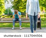 the girl leaves the young man.... | Shutterstock . vector #1117044506
