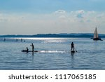 silhouette of stand up paddle...   Shutterstock . vector #1117065185