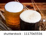 two glasses brown and golden... | Shutterstock . vector #1117065536