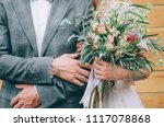 hands of the groom with the... | Shutterstock . vector #1117078868
