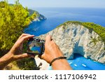 the tourist takes pictures of... | Shutterstock . vector #1117106942
