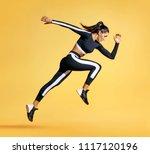 sporty woman runner in... | Shutterstock . vector #1117120196