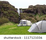 camping tents near waterfall ...   Shutterstock . vector #1117121036