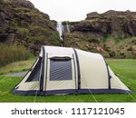 camping tent near waterfall ... | Shutterstock . vector #1117121045