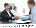 handshake business partners at... | Shutterstock . vector #1117123955