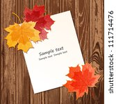 maple leaves with paper sheet... | Shutterstock .eps vector #111714476