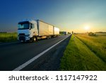 trucks driving on the asphalt... | Shutterstock . vector #1117147922