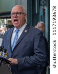 Small photo of New York City, N.Y. - JUNE 9: U.S. Rep. Joseph Crowley discusses a two-year, $43 million plan to repaint the lead-laced 7 train tracks Jackson Heights neighborhood of Queens with