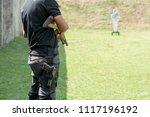rear view man holding shotgun... | Shutterstock . vector #1117196192