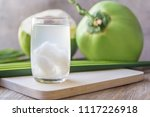 coconut juice on wooden table... | Shutterstock . vector #1117226918