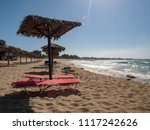 sunshades on the beach at... | Shutterstock . vector #1117242626