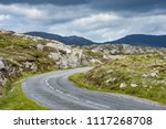 road winding through the rocky... | Shutterstock . vector #1117268708