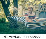 young man sitting in hammock...   Shutterstock . vector #1117320992