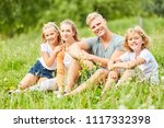 happy family and two kids is... | Shutterstock . vector #1117332398